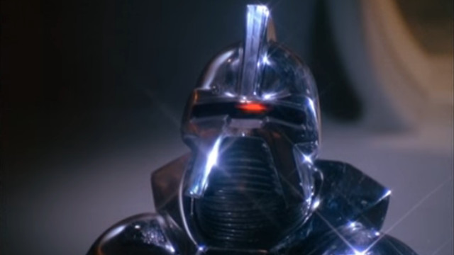 A Cylon from BSG of old - I forgot about the, er, 'mohican' on top, though